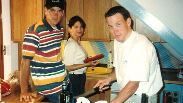 Happier times: Armstrong helps prepare a meal for Frankie Andreu (left) and his wife Betsy