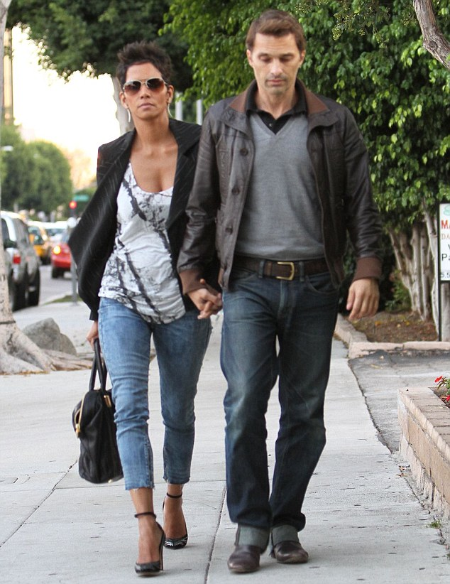 Date night: Meanwhile, his ex Halle Berry was seen Saturday having a romantic meal at Matsuhisa with her fiancé Olivier Martinez in Beverly Hills