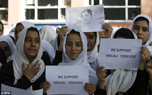 Support: Afghan students show their support for Malala who was shot on the school bus by Taliban extremists