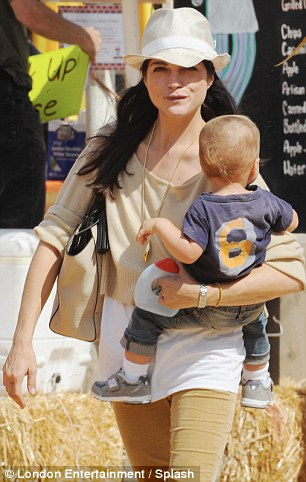 Keeping close: The singer mother carried her tot around the West Hollywood location for part of the trip