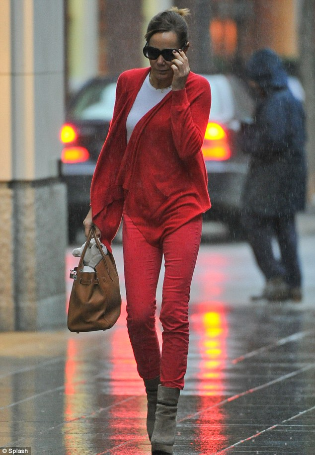 Run Tara! Palmer-Tomkinson seen arriving at the Richard Ward salon on King's Road, London, in the pouring rain