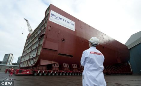 Business as usual: BAE workers moving a section of HMS Queen Elizabeth, the first of two new aircraft carriers