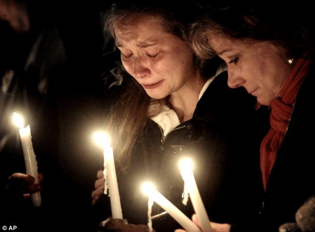 From left: Meghan Hoyt, Lizzi Marriott's best friend, and Sue Gendron, both of Westboro, shed tears at last night's candlelight vigil