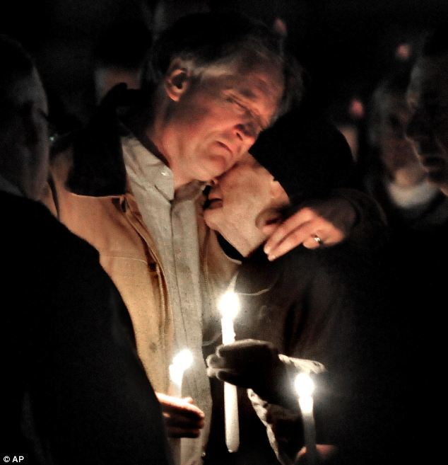 """Vigil: Devastated Robert Marriott holds a candle for his daughter, Elizabeth """"Lizzi"""" Marriott, a University of New Hampshire student, who disappeared earlier in the week"""