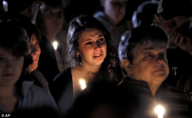 United in grief: A young woman cries for Lizzi Marriott, who disappeared earlier in the week and is believed to be dead