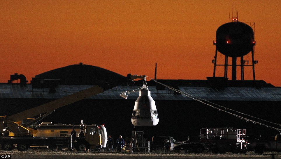 Sunrise skydive: Workers prepare at the launch site, ahead of an attempt by Felix Baumgartner to break the speed of sound with his own body by jumping from a space capsule lifted by a helium balloon