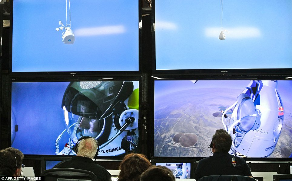 Mission control: The members of Baumgartner's team keep an eye on the extreme skydiver as he ascends further and further above Earth