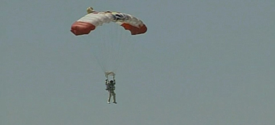 Chute: Baumgartner floats down to the ground with the help of a parachute after the successful leap