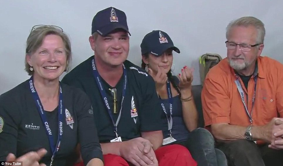 Pride: Members of Baumgartner's family watch triumphantly as he completes the jump