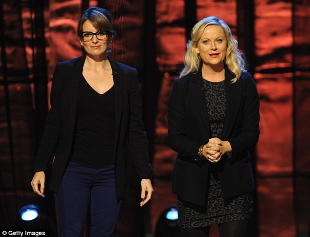 Funny girls: Saturday Night Live pals Tina Fey and Amy Poehler ham it up for the crowd