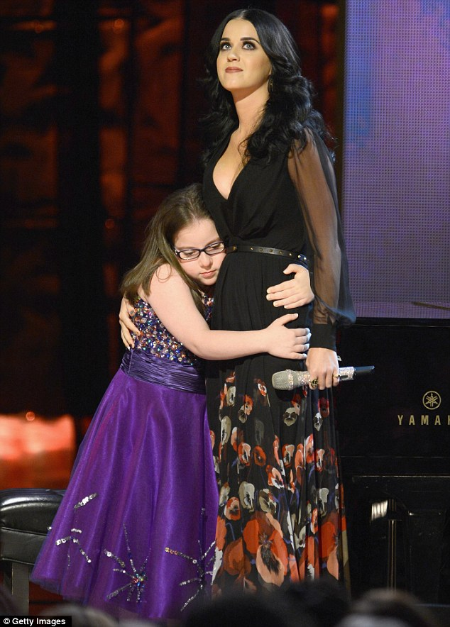 Fanhood: The singer gets a hug from a her piano performer