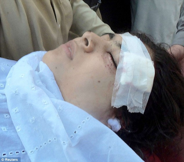 Injured: Hospital staff assists Malala at the Saidu Sharif Teaching Hospital in the Swat Valley