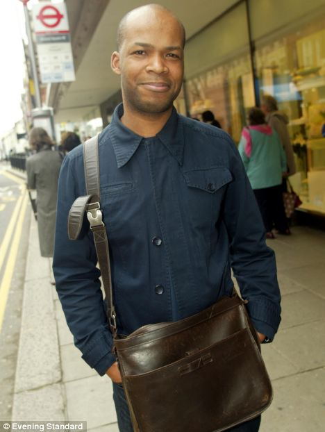 Andy Fagan, is pictured with his leather 'man bag'. Four in five men now carry one and the trend has been put down to the need to carry an ever-growing number of electronic gadgets
