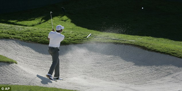 Trap: Jhonattan Vegas is forced to hit out of a bunker on the 17th in California