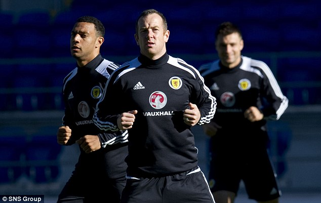 Another go: Charlie Adam and his Scotland team-mates were in Cardiff on Sunday preparing for their trip to Belgium