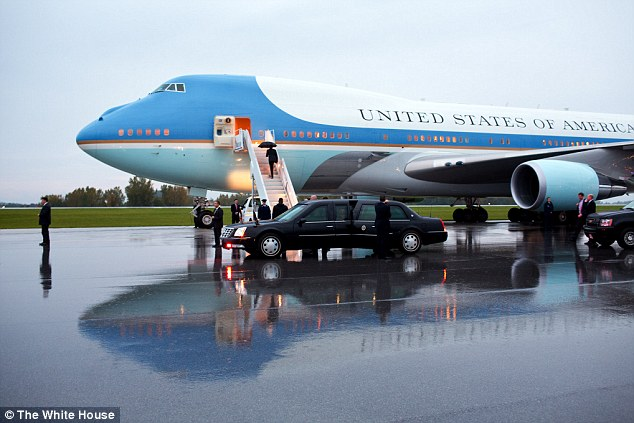 Raining: President Barack Obama boards Air Force One at Akron-Canton Regional Airport in North Canton, Ohio, on September 26