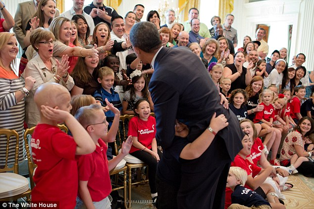 All smiles: President Barack Obama greets participants after posing for a group photo with Children's Miracle Network Champions in the East Room of the White House, on September 19