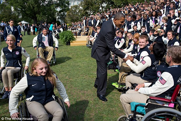 Hugs and handshakes: President Barack Obama greets athletes during an event honoring the 2012 United States Olympic and Paralympic Teams at the White House on September 14