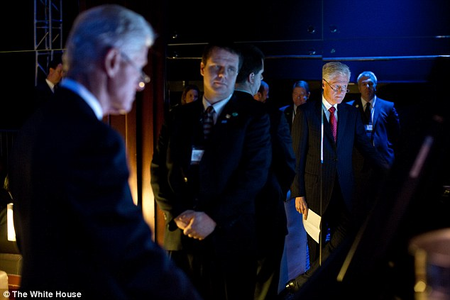 Support: Former President Bill Clinton watches from backstage as President Barack Obama delivers remarks at the Clinton Global Initiative annual meeting at the Sheraton New York Hotel and Towers in New York, N.Y. on September 25