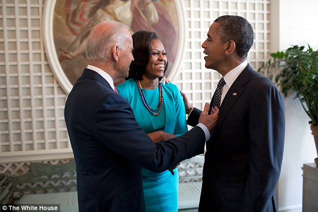 Let me fix your tie: President Barack Obama, First Lady Michelle Obama and Vice President Joe Biden, left, talk in the West Garden Room of the White House, prior to an event with the 2012 U.S. Olympic and Paralympic Teams on the South Lawn, September 14