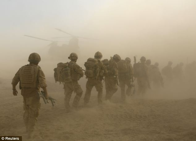 Mass pullout: British soldiers from B Company, 2 Mercian, board a Chinook helicopter on an operation in Malgir, Helmand province