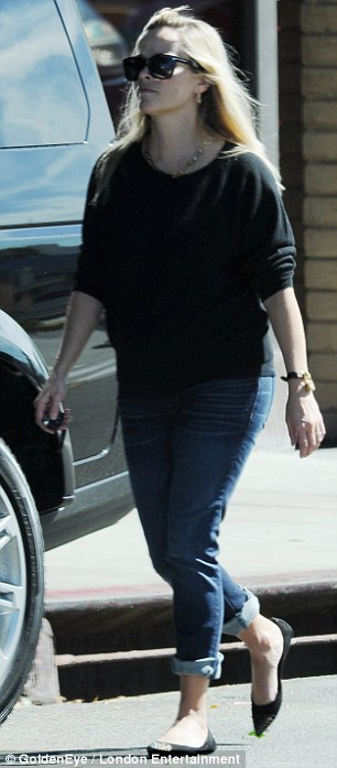 Back in her jeans: The blonde has packed away her maternity wear