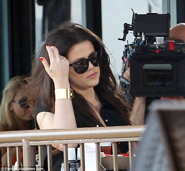 It's all mine: Khloe wearing her ring