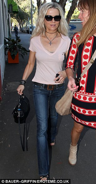 Taking its toll: Danielle looked very skinny and sombre in Sydney on Sunday