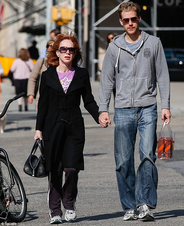 The couple that train together: Kathy and Randy both wore sneakers to pad about Manhattan