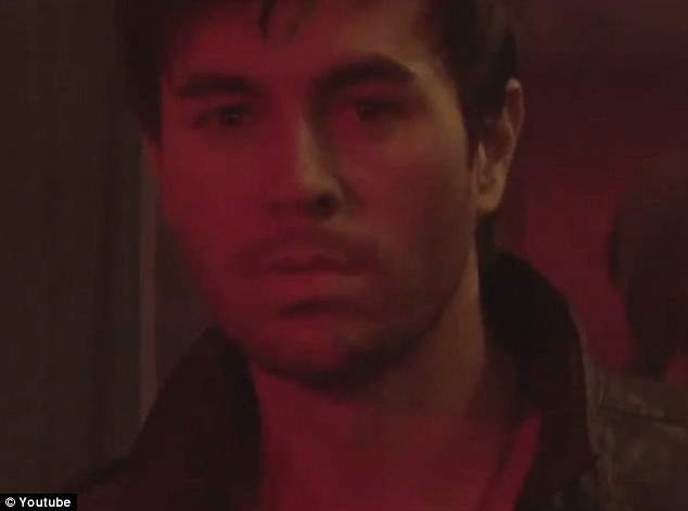 Longing look: Enrique smoulders in the video's disco scene