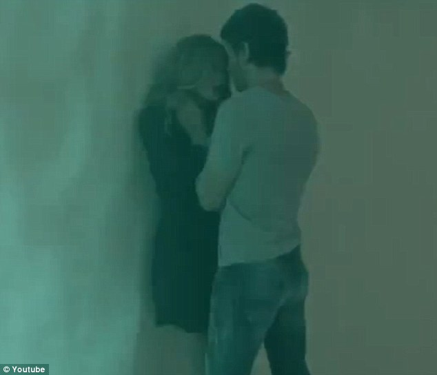 Cornered: Enrique gets cosy with a lovely lady in the Finally Found You music video
