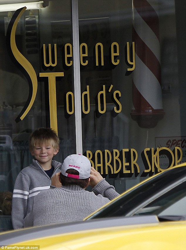 Getting snapped: Ashton takes a picture of his nephew outside Sweeney Todd's Barber Shop