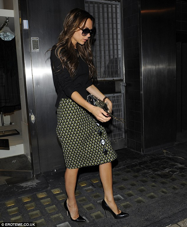 Perfect in Prada: Victoria wore the same outfit she arrived at Heathrow in and took to Twitter to gush about the Prada print on her pencil skirt