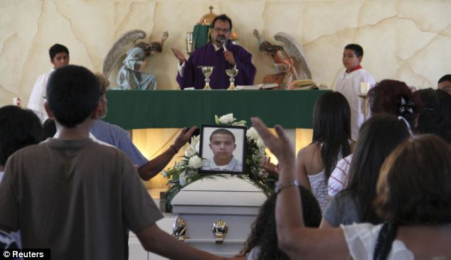 Relatives pray at the funeral of 16-year-old Jose Antonio Elena Rodriguez, who was killed when a U.S. Border Patrol agent fired at suspected drug smugglers across the border into Mexico