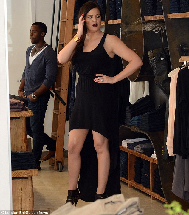 Vamping it up: Khloe Kardashian looks sultry in a revealing black dress, spiky black heels and a gold bracelet at the Dash store in Miami Beach on Monday