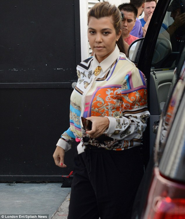 Mumsy: The reality show star looked a little frumpy in her shirt and broach at the collar