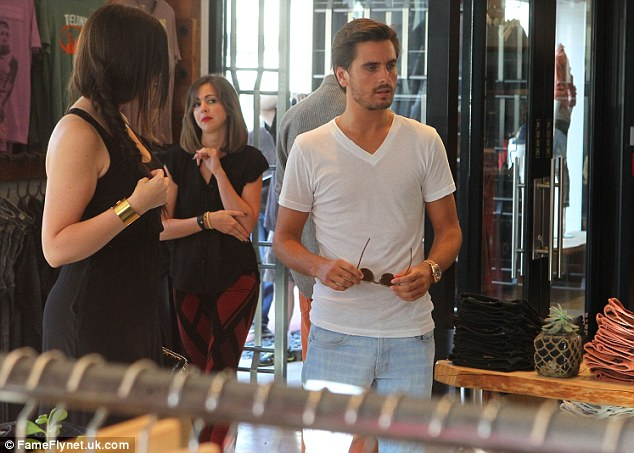 Staying cool: Kourtney and Scott looked around the store together, with Scott sporting a v-neck white T-shirt and pale blue jeans