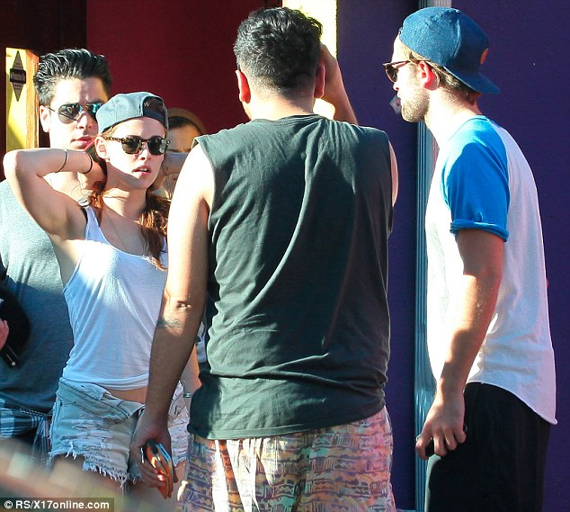 Moving on: Kristen Stewart and Robert Pattinson were pictured together today having lunch with friends in Hollywood on one of the first occasions since their Kristen's fling with director Rupert Sanders