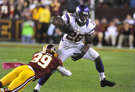All day: All-Pro running back Adrian Peterson is grabbed by Redskins cornerback Richard Crawford