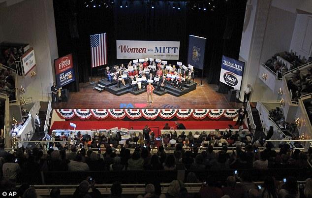 Winning them over: Mrs Romney spoke to women who she promised a better deal under her husband Mitt's presidency