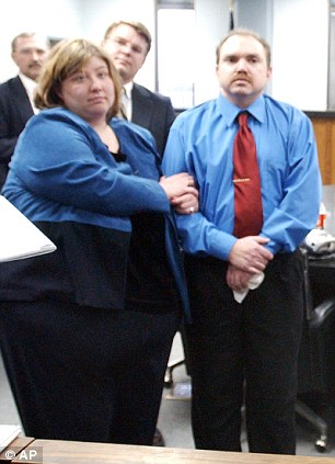 Popcorn couple: Eric Peoples, right, and wife Cassandra have filed for bankruptcy after winning a $20 million verdict in 2004