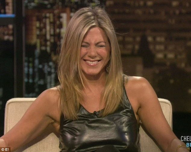 Embarrassed: Jennifer Aniston gets flustered when her friend draw attention to her prominent nipples on the Chelsea Lately show