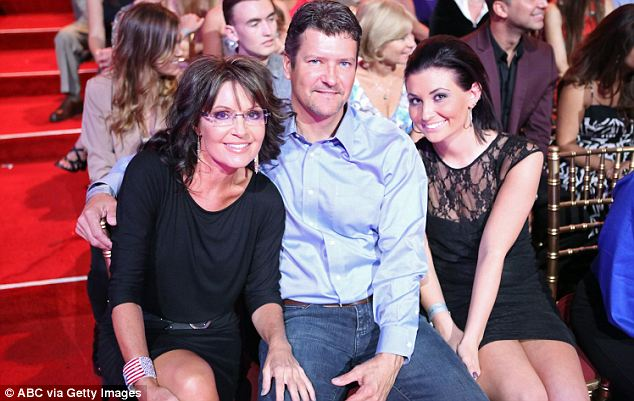 Immediate connection: Palin, seen here with her husband Todd and daughter Willow has similar English roots as Berry