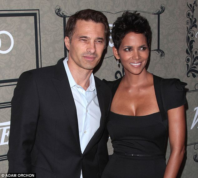 European roots: Berry, seen here with fiance Olivier Martinez, was born in Ohio but her mother's side is English