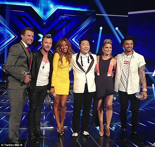 He's got the X Factor: Mel later posted this snap on her Twitter page of her with show host Luke Jacobz, Ronan Keating, Psy, Natalie Bassingthwaighte and Guy Sebastian