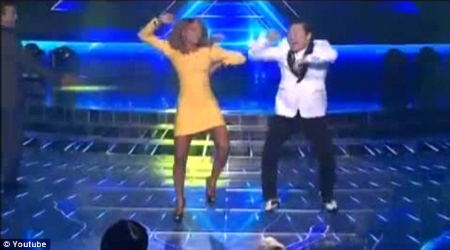Going for it: Mel B joined South Korean rapper Psy on stage to perform the now legendary Gangnam Style dance