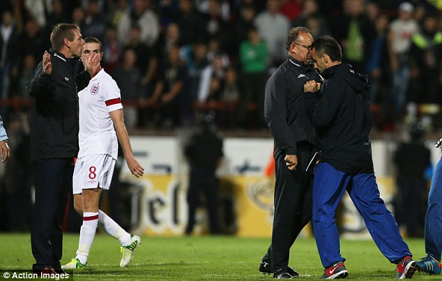 Assault: England coach Martin Thomas is headbutted by a member of the Serbian coaching team (right) as Stuart Pearce looks on