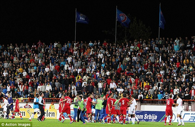 Brawl: The fight breaks out between England and Serbia Under 21s on Tuesday night