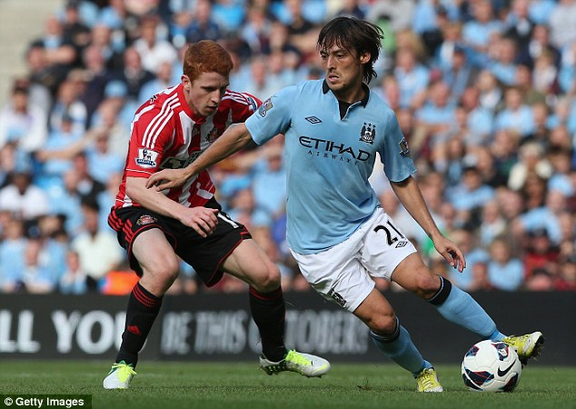 Midfield master: Silva's absence will be keenly felt at the heart of the City side