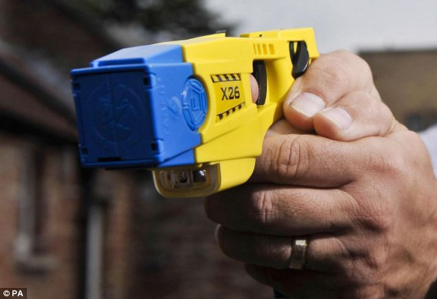 A police officer holding a Taser stun gun during a training exercise (file photo)